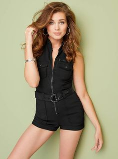 AXEL BELTED MOTO ROMPER. This street-style approved moto romper features a sleeveless construction, a mock-neck collar, front utility and patch pockets, along with a D-ring belted waist. Front zipper closure.