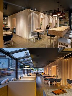 Rope room dividers were used to create sections in a modern restaurant.