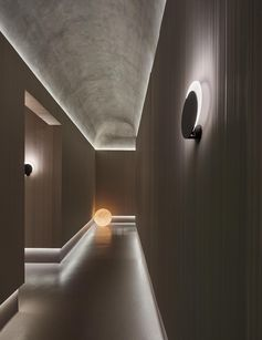 Hidden lighting lines the ceiling and floor in this hallway.