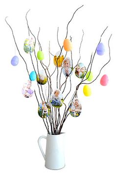 Easter Photo Tree - For a pretty display or centerpiece, try this unique twist on an Easter tree. You can even use photos on your phone by printing them using the My Kodak Moments app. Download it for iOS or Android --> http://kodak.ly/1bJai1N #Easter #photo #photography #DIY #display #craft #project #inspiration #idea #decor #decoration #decorating