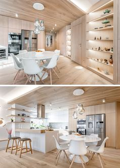 This modern apartment features built-in angled shelving that's adjacent to the dining area. Three sculptural glass pendant lights hang above the dining table, anchoring it in the open space. #ModernApartment #CustomShelving #BuiltInShelving #InteriorDesignIdeas #ApartmentIdeas #WoodLined #DiningRoomIdeas