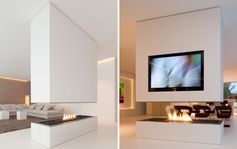 A minimalist white room divider with a fireplace and a recessed television.