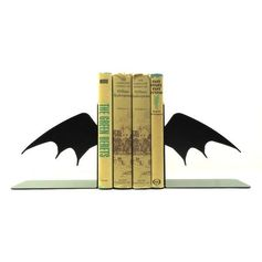 Bat Wing Bookends BATMAN Fanatics or just a fan of these night creatures?! Store your favorite movies or book collection in this awesome set of bookends! Made from solid steel, these bookends are heavy enough to hold up your reading collection. Sold in a set of two pieces, finished in hammered black. Dimensions are app