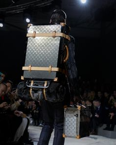 Titanium sherpa trunk at the Louis Vuitton Fall-Winter 2018 Fashion Show by Kim Jones. See all the looks now at louisvuitton.com.