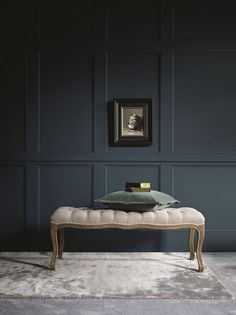 Wainscoting - raised wooden panelling - is something I'm quite partial to.  It adds personality and dimension to your walls, and although it dates back  to colonial days, you can give it a contemporary spin by simplifying the  design and/or having fun with the colour.  This original dark wood p