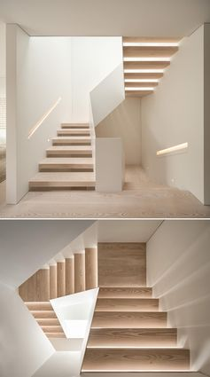 Light wood and white stairs have built-in handrails with hidden lighting.
