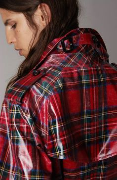 A high-gloss laminated Burberry wool trench coat in Modern Stewart Royal tartan. The relaxed cut has a pronounced storm shield and inverted box pleat at the back for volume. Mix your patterns to make the plaid pop.