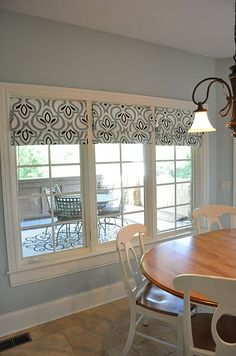 Roman shades made from a Target tablecloth and tension rods.