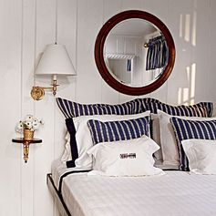 Sail Away / For a yacht-like look, dress a built-in bed with navy and white. Brass fixtures and polished wood accents enhance the stateroom effect.