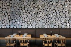 A restaurant accent wall made from plates and bowls.