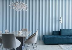 A Light Blue Ribbed Accent Wall Adds A Soft Texture To This Living Room