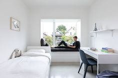 In this modern teen's bedroom, the bay window includes a comfortable window seat with views of the neighborhood. #WindowSeat #ModernBayWindow #BedroomIdeas