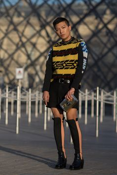 Bryan Boy wearing a Louis Vuitton pullover from the Women's Fall-Winter 2017 Collection, attending the Louis Vuitton Spring-Summer 2018 Fashion Show at Musée du Louvre, Paris.