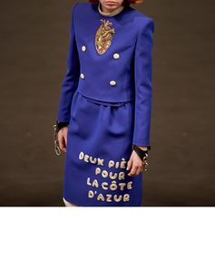 A French phrase appears on a women's tailored skirt suit by #AlessandroMichele, seen before being presented in the Gucci Spring Summer 2019 fashion show, 'Deux Pièces Pour La Côte d'Azur' (two-piece for the French Riviera).