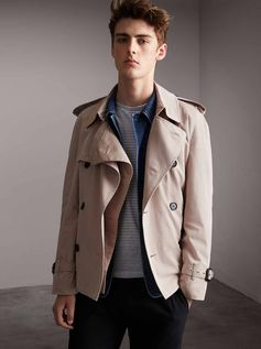 Created for him and for her, an English-crafted trench jacket in new lightweight tropical gabardine. The tonic-coloured cotton twill is woven for weatherproof protection at the Burberry mill, and tumbled and washed to imbue softness and fluidity. The airy and relaxed cut is accentuated through a beltless silhouette with minimal lining.
