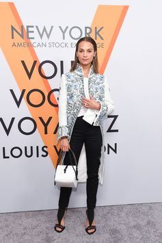 Alicia Vikander wearing a look from the Spring-Summer 2018 Collection by Nicolas Ghesquiere at the opening of the Louis Vuitton Volez, Voguez, Voyagez Exhibition at the historic American Stock Exchange in New York City.