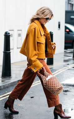 Autumnal tones spotted on Lucy Williams at London Fashion Week.  Find this Marques Almeida jacket on Farfetch now.