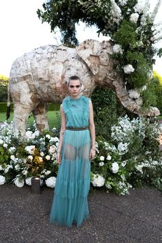 Cara Delevingne wears a Burberry pleated tulle gown to the Save The Elephants dinner in London