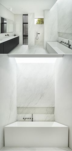 A white bathroom with a shelving niche and a skylight.