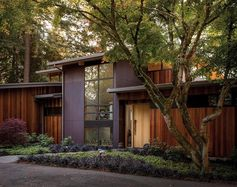 This modern single-family house with exterior materials of ipe wood siding and weathering steel.