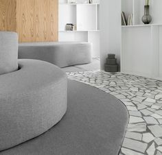 A mosaic marble floor in grey and white.