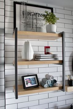 Shelving Ideas - This custom shelf in a renovated bathroom complements the rest of the apartment that has an modern industrial appearance. #ShelvingIdeas #ShelvingDesign #ModernShelf #BathroomShelf