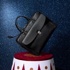 These holidays, choose a gift you can enjoy every day. Discover this Tod's briefcase in leather and many other gift ideas at tods.com #TodsLovesCircus