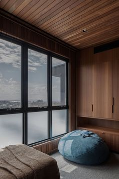 The lower windows in this wood-lined bedroom are opaque to allow for privacy from the neighborhood. #OpaqueWindows #PrivacyWindows #WindowIdeas #WoodBedroom