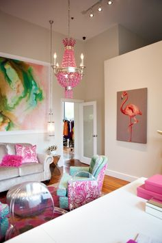 Love the flamingo painting, glass door leads to more clothing racks