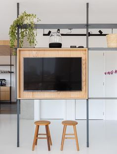 A Multi-Functional Room Divider Helps To Define The Spaces In This Apartment
