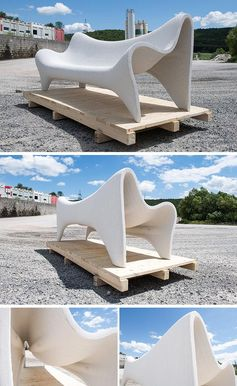 A 3D printed outdoor sofa that's made fro white concrete.