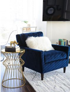 navy velvet paired with a textured pillow + gold side table...love