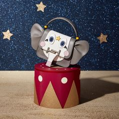 The cutest baby elephant takes the scene in the Tod's Loves Circus: choose the happiest gifts of the season at tods.com! #todsdoublet #TodsLovesCircus