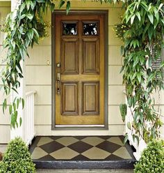 the faux look to the door... and the painted cement stoop!