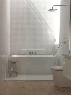 Main Bathroom, Gloss white 30x30 tiles, Matt White 600 x 600 tiles, Baltic Pine Floor, Calcutta Marble Benchtop Minimal white bathroom