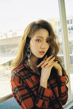 Lee Sung Kyung features in Marie Claire KR's December issue wearing a Burberry tartan shirt and a crystal-embellished earring, shot by Mok Jung Wook