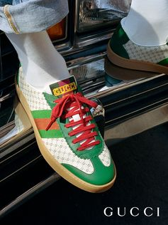 Low tops from the new Gucci-Dapper Dan collection feature the Web stripe and the yellow logo.