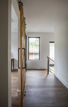 At the top of these stairs is a hallways with wood flooring. #Flooring #InteriorDesign #Hallway