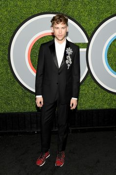Actor Tommy Dorfman wears a Burberry tuxedo styled with a chandelier brooch at the GQ Men of the Year 2017 Awards in Los Angeles