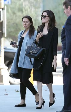 Angelina Jolie spotted in Los Angeles sporting a black Valentino Garavani Demilune bag characterized by the strong attitude of the iconic studs.