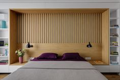 A Wall In This Bedroom Was Fully Built-In With Shelving, Headboard, And Side Tables
