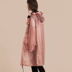 A hooded technical parka cut for an oversize fit. The shower-resistant design includes tonal piping at the mesh-lined hood and neckline, multiple front pockets, a drawcord at the hem. Comes with a packaway bag featuring Burberry lettering.