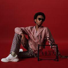 VLTN as interpreted by Parker Kit Hill.  Here portrayed Parker Kit Hill on the set after her dedicated dance Act while wearing a VLTN pink bomber jacket, #ValentinoEyewear and a transparent #VLTN bag.