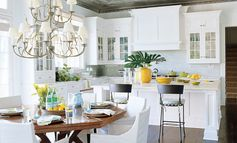 Beautiful kitchen featuring white cabinets and adjoining dining space by Christopher Peacock .