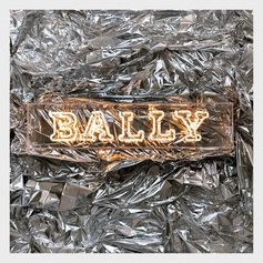 Bally's showroom in Milan takes a whole new look with this mountain inspired installation, realised with emergency foil blankets used by explorers.