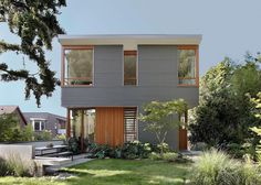 A modern house with corrugated metal siding and wood window frames.