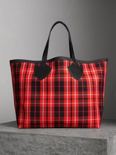 A supersized reversible tote in tartan check. The unisex bag is made from bonded cotton with contrasting sealed seams for an extra clash of colour.
