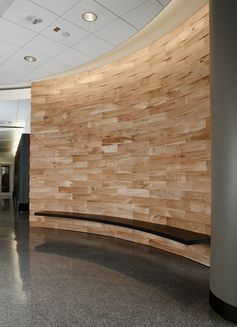 Accent Wall Ideas - 12 Different Ways To Cover Your Walls In Wood // Salvaged wood makes up this curved accent wall in a commercial space.