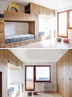 This modern kids bedroom has high ceilings, a sliding wood door, an open space for play, a wall of cabinets, and a bunk bed designed for three. #BunkBed #KidsRoom #ChildrensBedroom #Cabinets #BedDesign