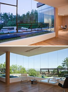 Home Office Ideas - This modern home office is located at the top of a staircase, and overlooks the pool and yard, and has views of the mountain ranges in the distance. #HomeOfficeIdeas #ModernHomeOffice #Windows
